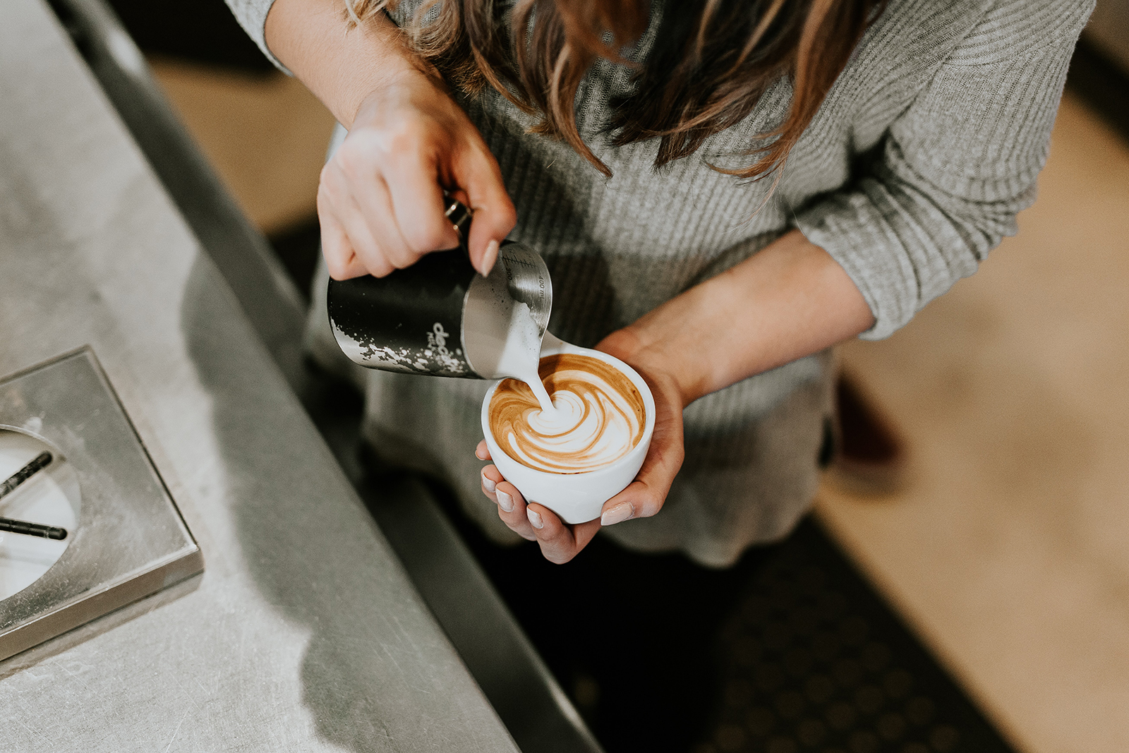 stock image f a barista pouring coffee