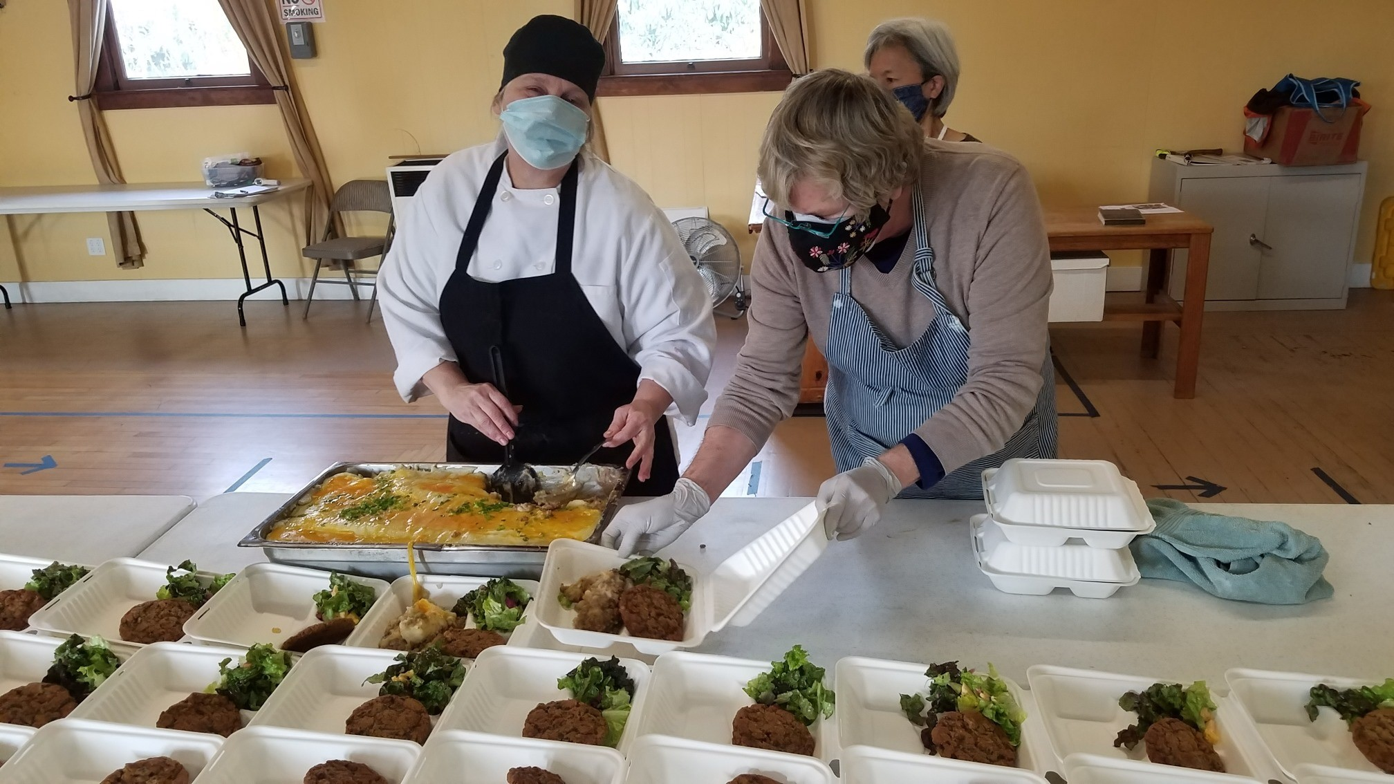 Sonoma Overnight Support received a grant for refrigeration units and worktables. The photo is them serving food at the Springs Hall